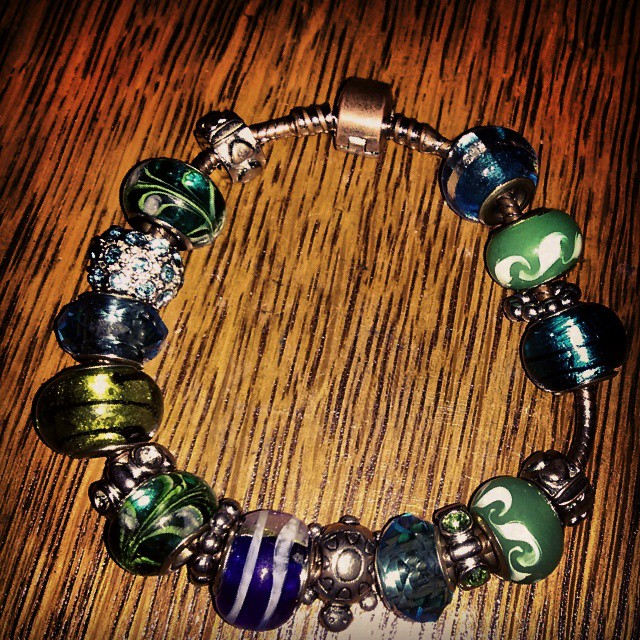 a photo of a pandora charm bracelet knockoff