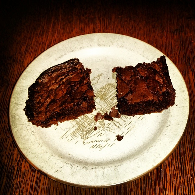 a photo of two brownies sitting on a plate