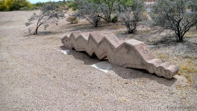 concrete snake sculpture