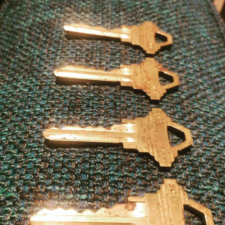 a photo of four brass keys lined up
