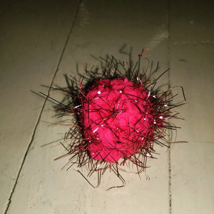 a photo of a cat toy made of fuzz and tinsel