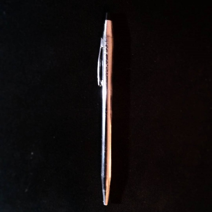a blurry photo of a silver pen