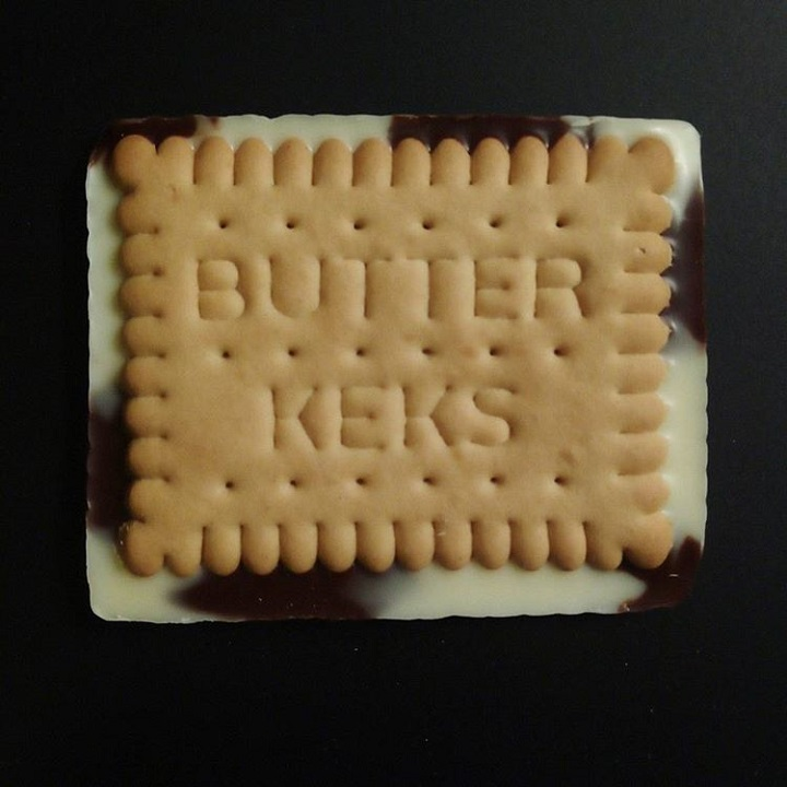 "a photo of the underside of a cookie which reads ""butter keks"""