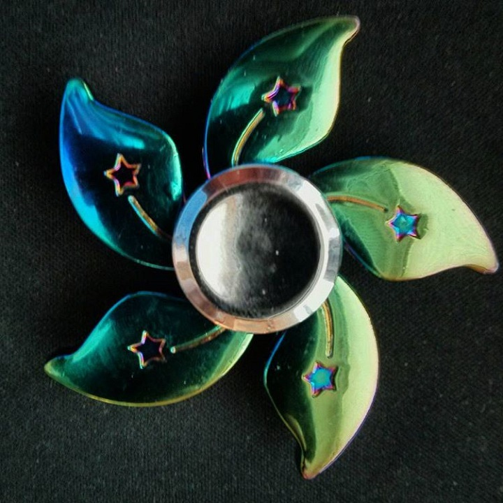 a metal fidget spinner that is shaped like the orchid from the hong kong flag