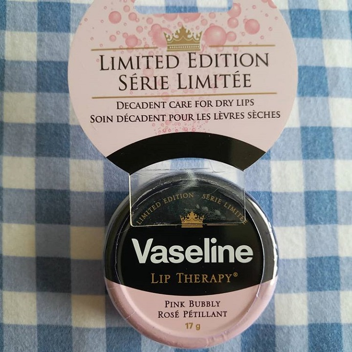 a photo of a tin of limited edition vaseline lip therapy in pink bubbly flavour