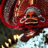 A Theyyam artist embodies the spirit of the Hindu deity 'Puliyoor Kannan'