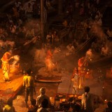 Puja ceremonial ritual at dusk on the ghats of the River Ganges