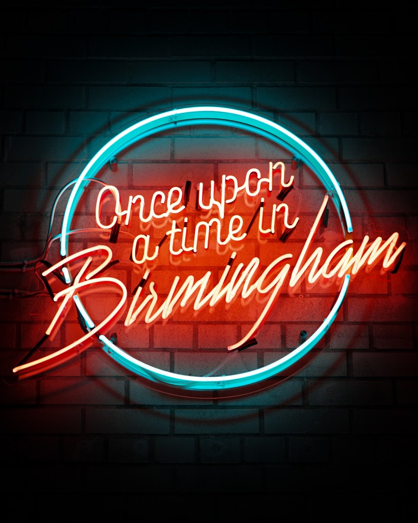 "A blue and red neon sign that reads ""Once upon a time in Birmingham"""