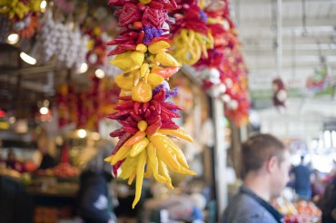Chilli garland hanging outside vegetable store in Pike Place Market in Seattle