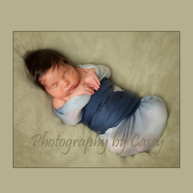 Swaddled poses for newborn photography