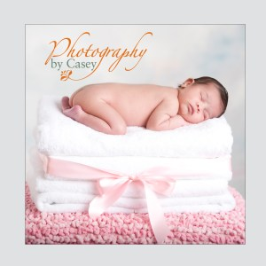 newborn baby sleeping on towels photographer
