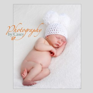 newborn baby in mouse ear cap photographer