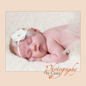 Sleeping newborn baby wearing tutu photography