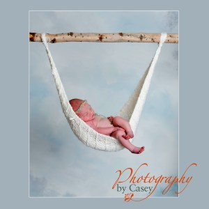 infant sleeping in hammock photographer