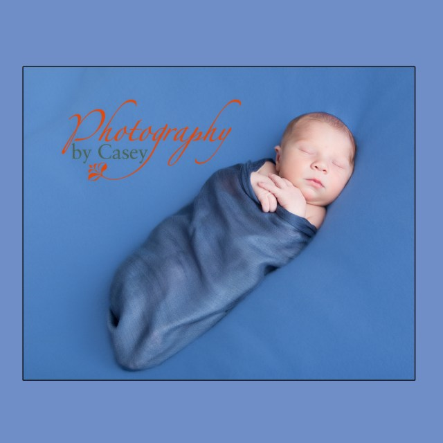 Newborn sleeping baby swaddled photography