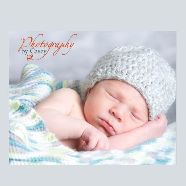 photography of newborn sleeping baby