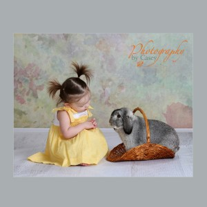 photography of little girl with bunny
