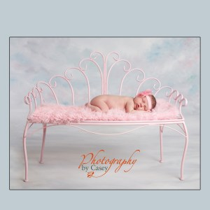 Sleeping Newborn on pink bench
