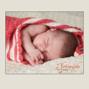sleeping newborn baby swaddled in blanket