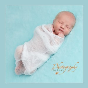 Newborn baby swaddled in muslin