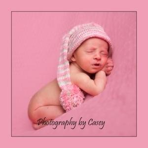 Photography of sleeping newborn in stocking hat