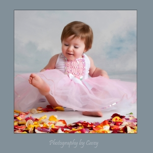Photographer of baby girl in tutu with rose petals