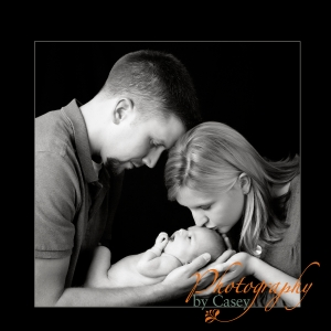 photography of Mom kissing newborn baby
