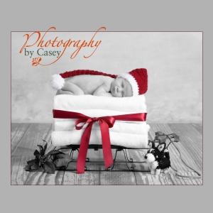 Sleeping newborn baby on sleigh