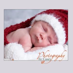 Sleeping newborn baby in Santa hat