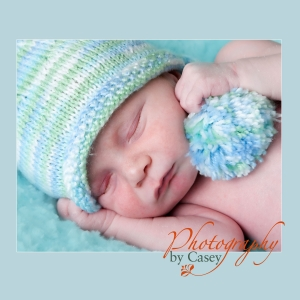 Sleeping newborn baby wearing stocking ha