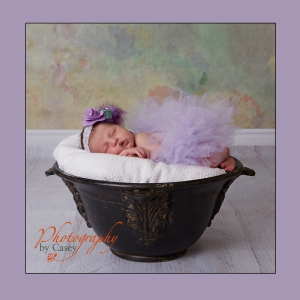 Newborn sleeping baby in ceramic pot