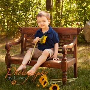 toddler photography with sunflowers
