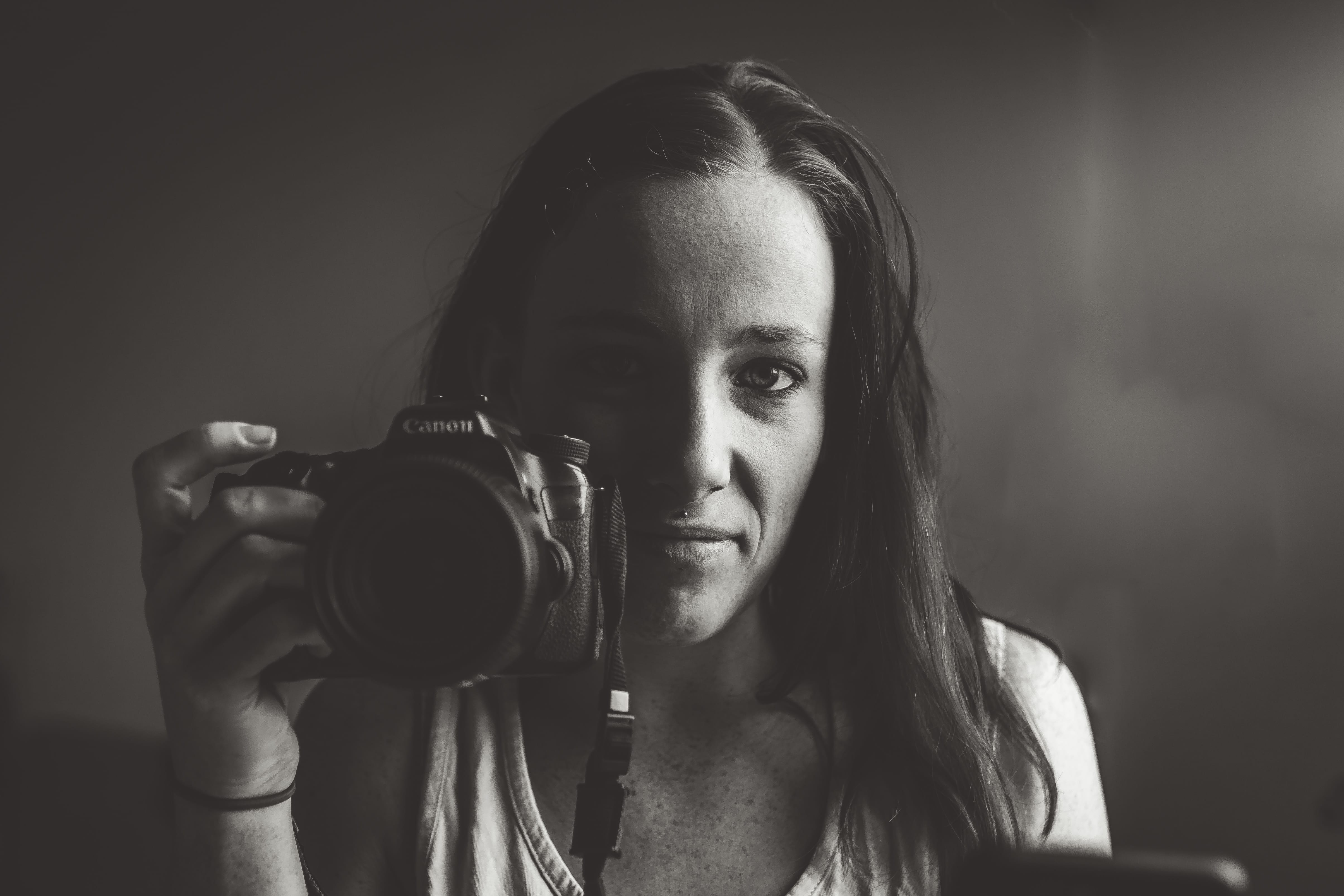 woman with camera self portrait