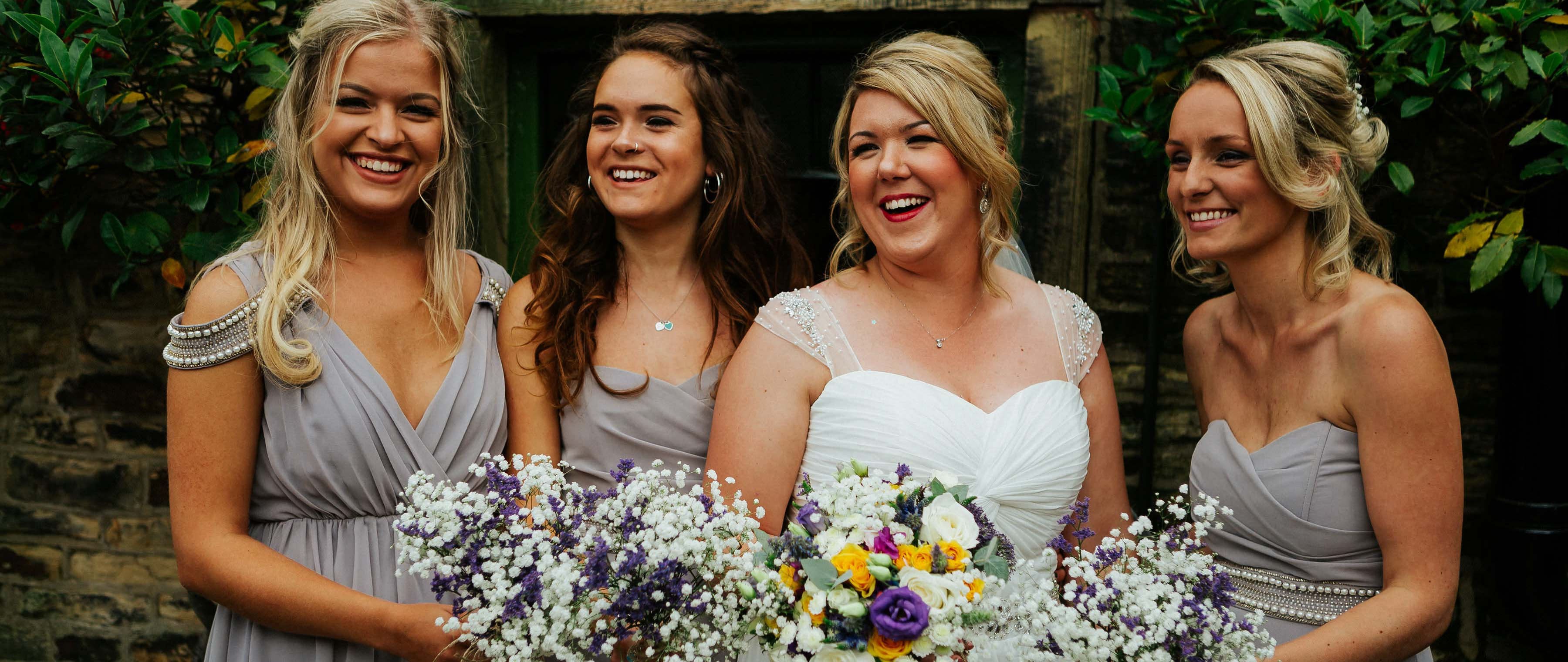 bridesmaids laugh together