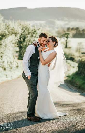 couple embrace on country lane