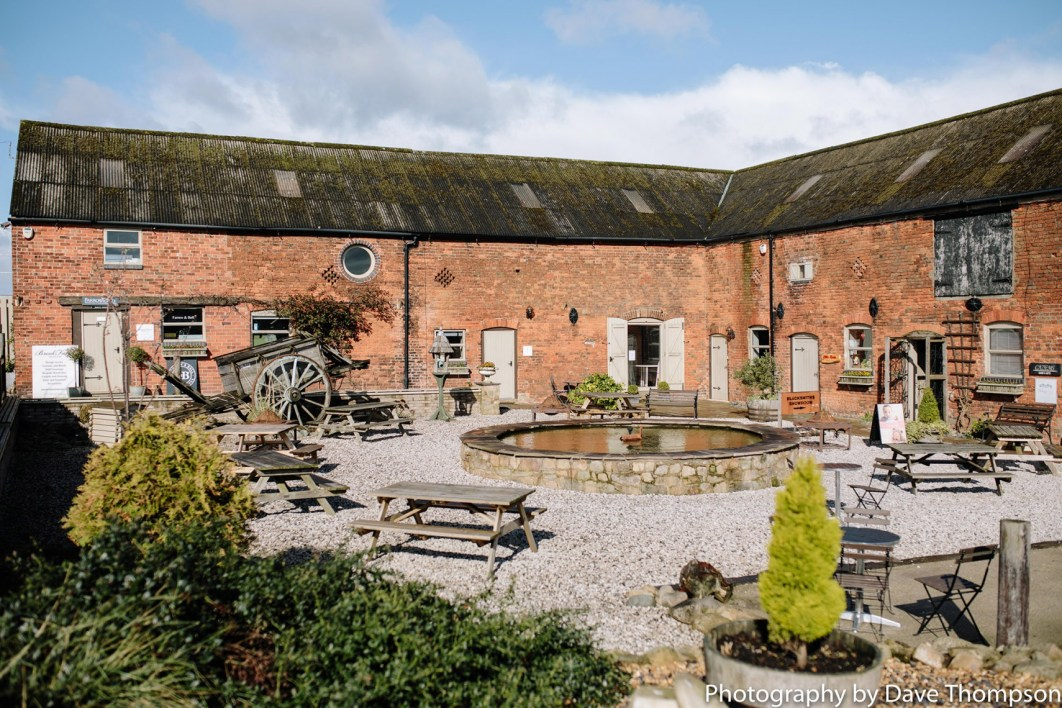 A view of the courtyard at Alcumlow Wedding Barn