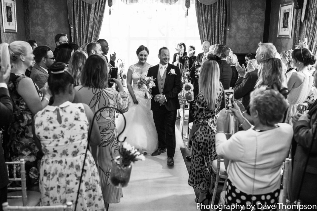 The bride and groom leave the Arboreum at Mere Court Hotel after their wedding ceremony