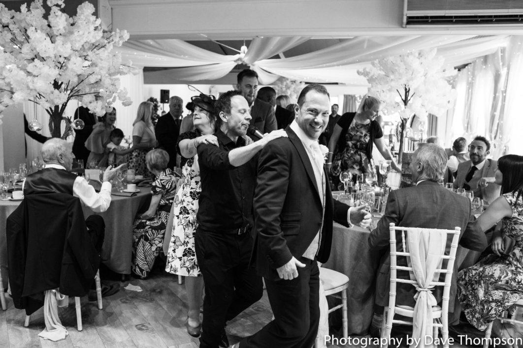The groom leads a conga around the room