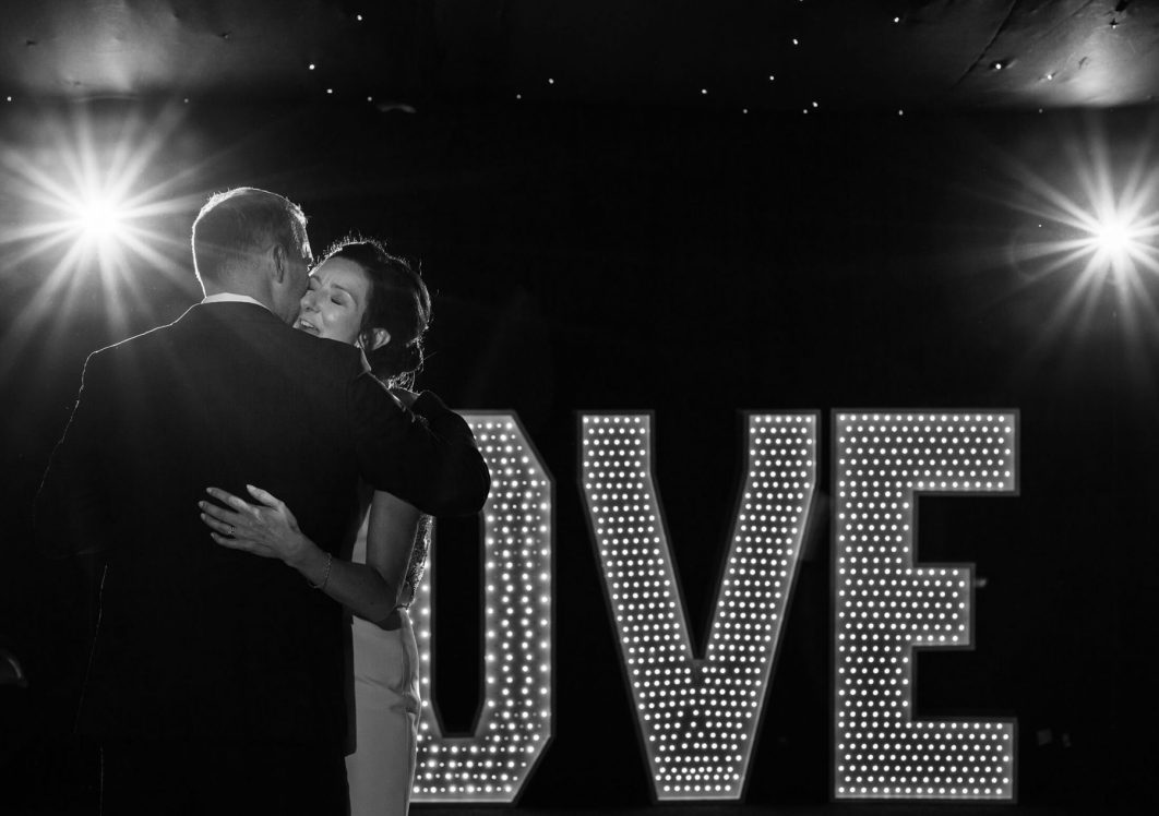 A black and white image of the bride and groom during their first dance.
