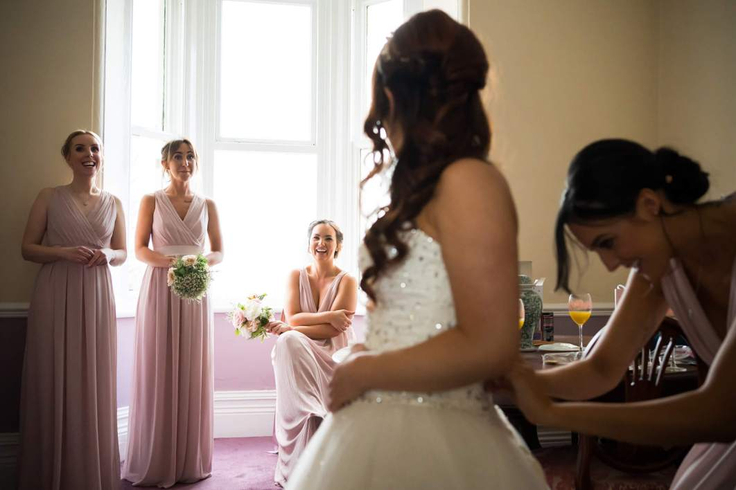 Hollin Hall Hotel Wedding Photographer - The bride laughs with her bridesmaides