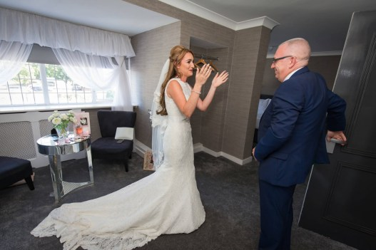 The bride sees her father arrive