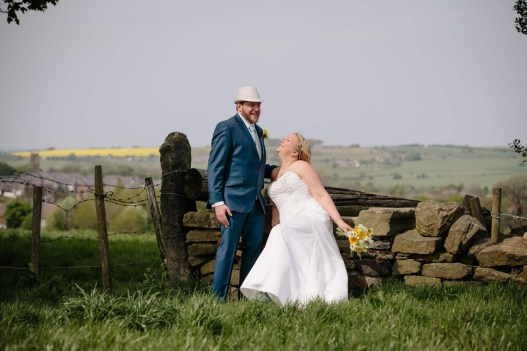 The bride and groom in a field in Penistone
