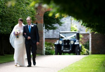 The father of the bride arrives with his daughter