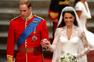 Prince William and Kate Middleton smile as they walk down the aisle
