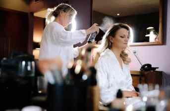 Hair dresser preparing the bride