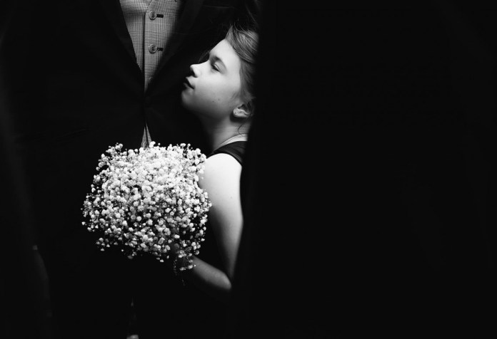 Flower girl and the groom