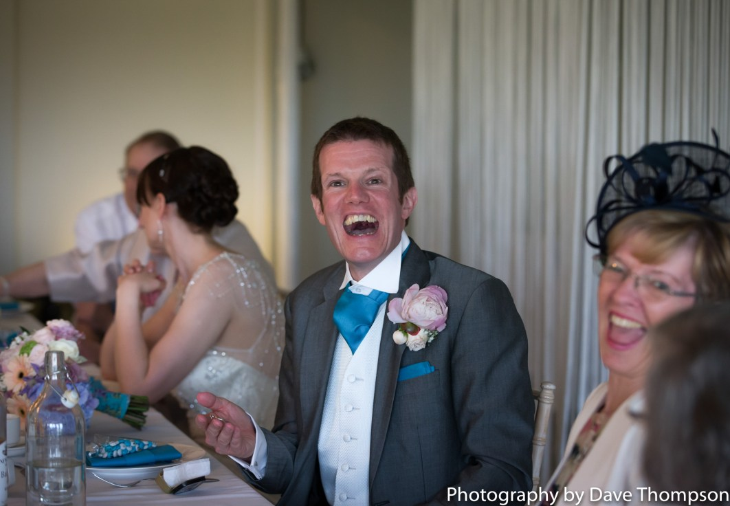 The goom laughs during the speeches