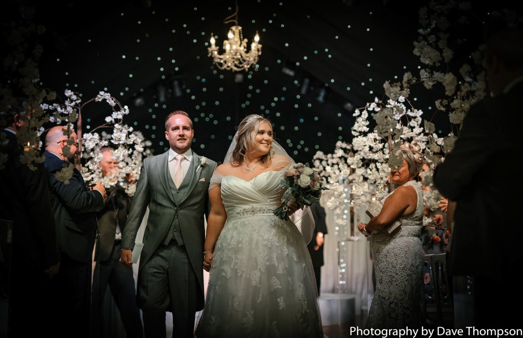 Man and wife walk down the aisle