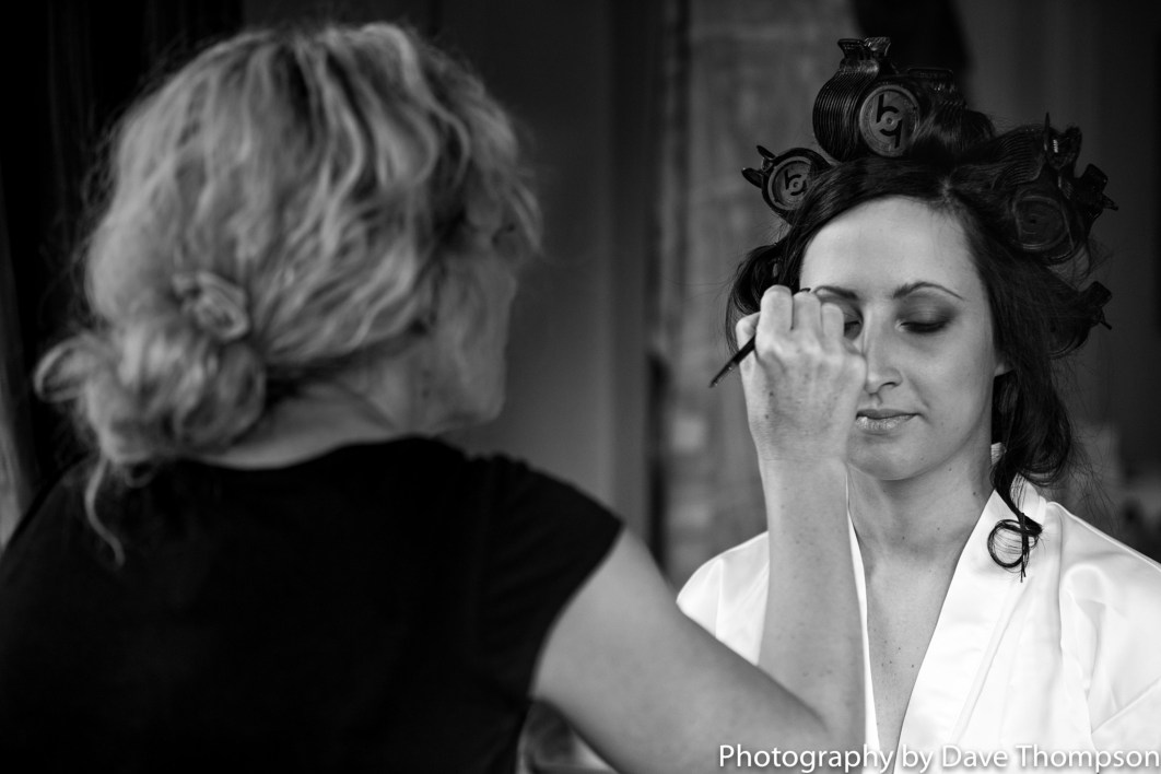 Bridal prep as eye make up is applied