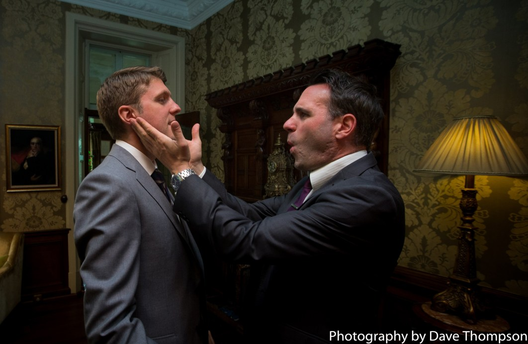 The best man slaps the cheeks of the grooms face